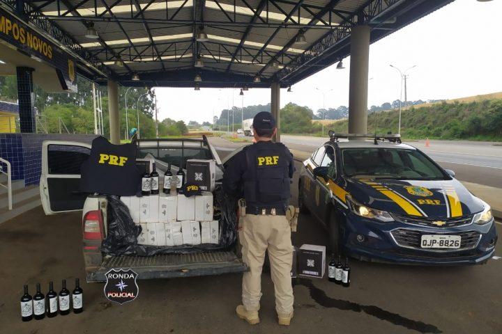 PRF prende motorista com mandado de prisão e transportando 540 garrafas de vinho na BR-282